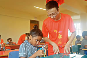 Hampton School pupils learning authentic Chinese paper cutting techniques